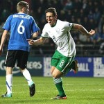 Keith Andrews runs off to celebrate after scoring Ireland's opening goal in Tallinn
