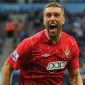 Rickie Lambert celebrates after scoring against Manchester City