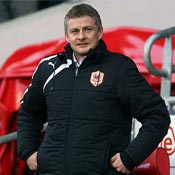 Ole Gunnar Solskjaer looks on as Cardiff City boss